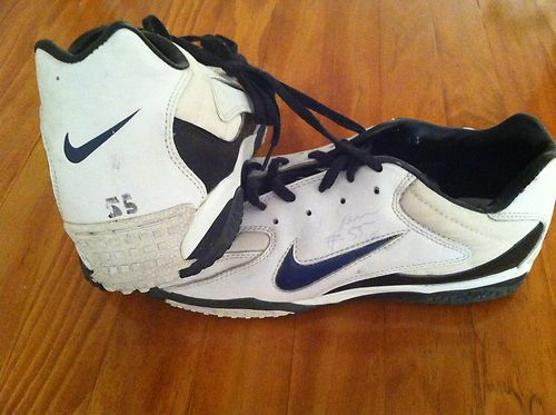 Junior Seau 1996 game worn autographed turf shoes