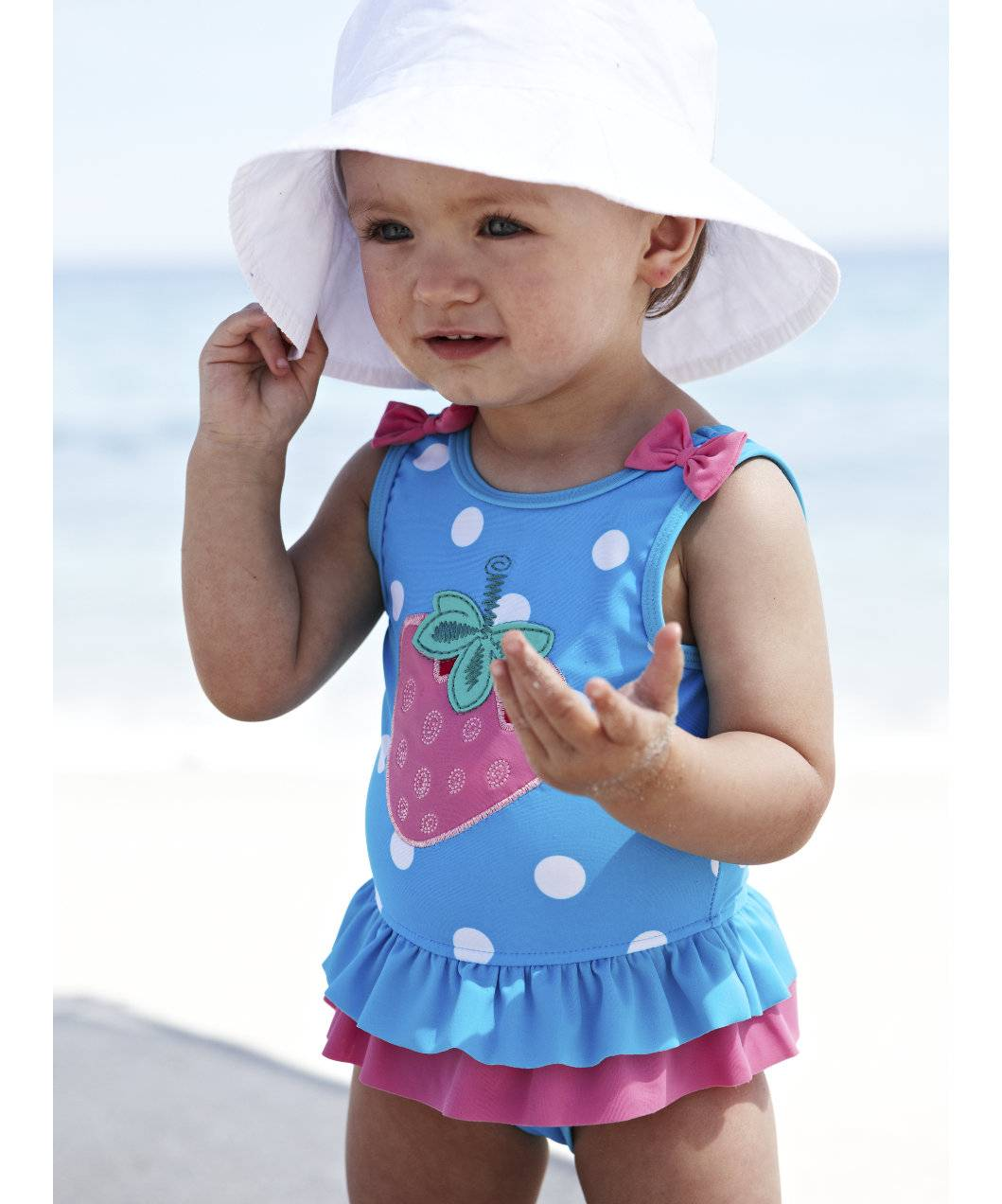Ruffles, tutus, red polka dots and blue stripes – our selection of infant and toddler girls' swimsuits has it all. Cute bikinis and colorful tankinis are great for afternoons by the pool with your baby girl, while snug rashgaurds and cover-ups help protect young skin during long days at the beach.