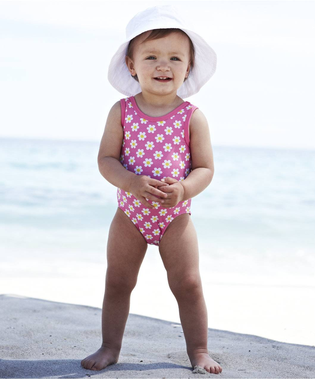 Dress little ones for fun in baby swimwear. Spending the day in the pool or by the lake is a great way for the whole family to have fun. It also gets your baby or toddler used to the water and prepares them to learn to swim when they're older.